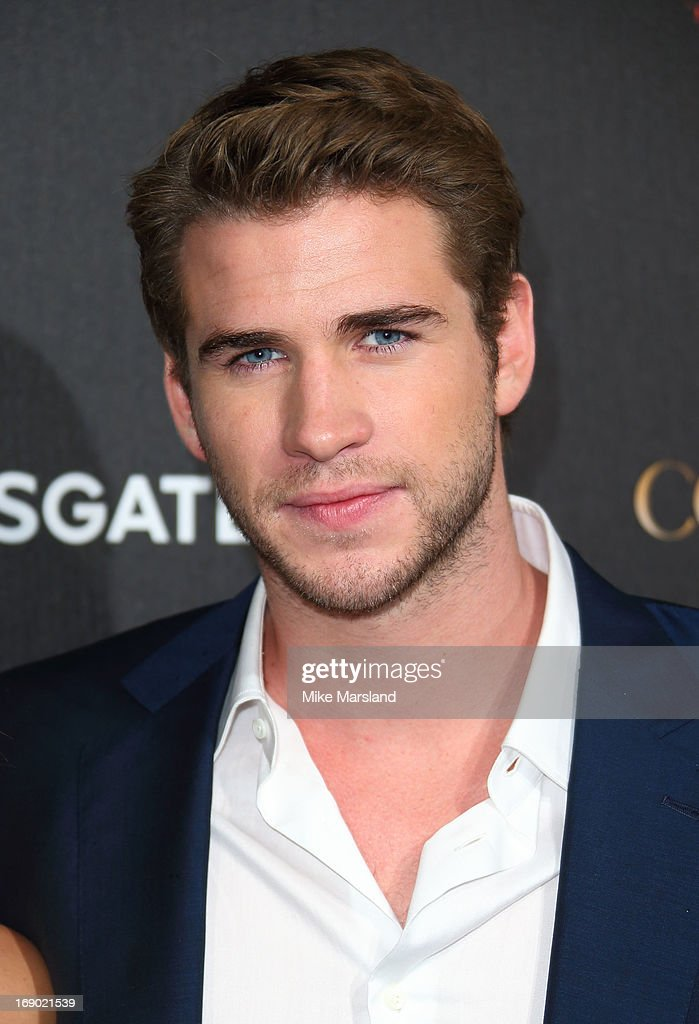 <a gi-track='captionPersonalityLinkClicked' href=/galleries/search?phrase=Liam+Hemsworth&family=editorial&specificpeople=6338547 ng-click='$event.stopPropagation()'>Liam Hemsworth</a> attends a party for 'The Hunger Games: Catching Fire' at The 66th Annual Cannes Film Festival at Baoli Beach on May 18, 2013 in Cannes, France.