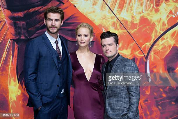 Liam Hemsworth Jennifer Lawrence and Josh Hutcherson attends the world premiere of the film 'The Hunger Games Mockingjay Part 2' at CineStar on...
