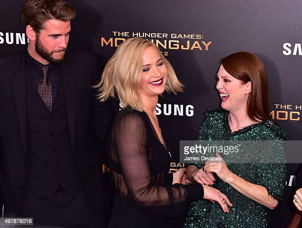 Liam Hemsworth Jennifer Lawrence and Julianne Moore attend the 'The Hunger Games Mockingjay Part 2' New York premiere at AMC Loews Lincoln Square 13...