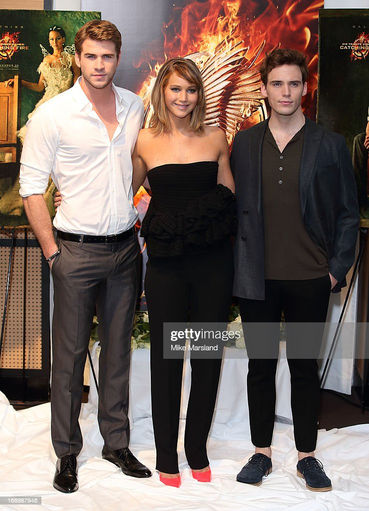 <a gi-track='captionPersonalityLinkClicked' href=/galleries/search?phrase=Liam+Hemsworth&family=editorial&specificpeople=6338547 ng-click='$event.stopPropagation()'>Liam Hemsworth</a>, <a gi-track='captionPersonalityLinkClicked' href=/galleries/search?phrase=Jennifer+Lawrence&family=editorial&specificpeople=1596040 ng-click='$event.stopPropagation()'>Jennifer Lawrence</a> and <a gi-track='captionPersonalityLinkClicked' href=/galleries/search?phrase=Sam+Claflin&family=editorial&specificpeople=7238693 ng-click='$event.stopPropagation()'>Sam Claflin</a> attend the photocall for 'The Hunger Games: Catching Fire' at The 66th Annual Cannes Film Festival at Majestic Hotel on May 18, 2013 in Cannes, France.