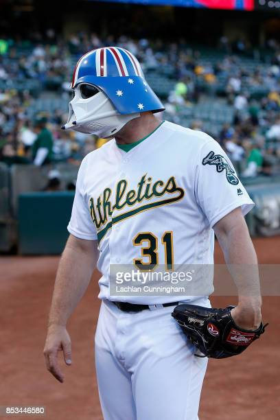 Liam Hendriks of the Oakland Athletics wears a Star Wars Storm Trooper mask with an Australian flag design before the game against the Texas Rangers...