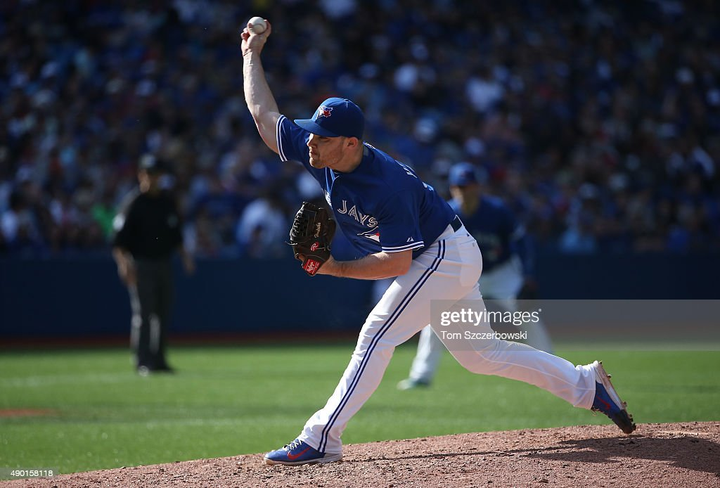 Liam Hendriks #31 of the Toronto Blue Jays delivers a pitch in the seventh inning during MLB game action against the Tampa Bay Rays on September 26, 2015 at Rogers Centre in Toronto, Ontario, Canada.