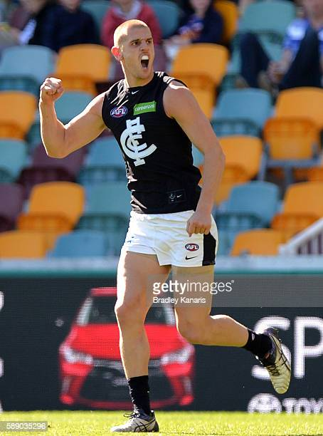 Liam Jones of the Blues celebrates during the round 21 AFL match between the Brisbane Lions and the Carlton Blues at The Gabba on August 13 2016 in...