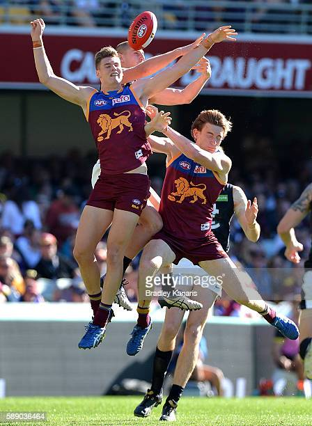 Liam Jones of the Blues gets above the pack during the round 21 AFL match between the Brisbane Lions and the Carlton Blues at The Gabba on August 13...
