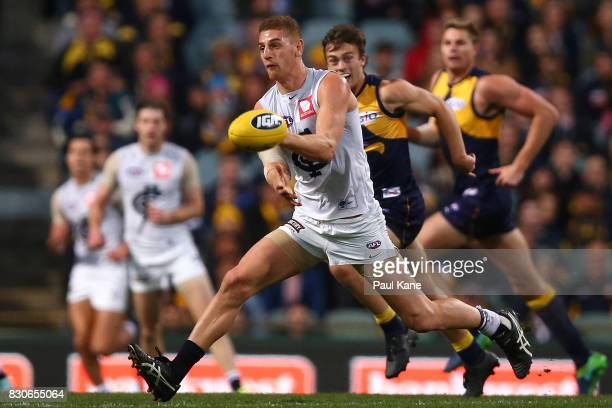 Liam Jones of the Blues handballs during the round 21 AFL match between the West Coast Eagles and the Carlton Blues at Domain Stadium on August 12...