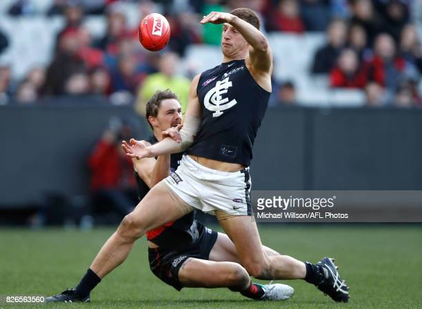 Liam Jones of the Blues is tackled by Joe Daniher of the Bombers during the 2017 AFL round 20 match between the Essendon Bombers and the Carlton...