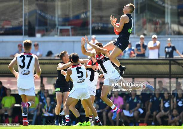 Liam Jones of the Blues marks over the top of Nathan Brown of the Saints during the 2017 JLT Community Series AFL match between the Carlton Blues and...