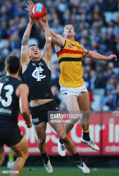 Liam Jones of the Blues marks the ball against Josh Jenkins of the Crows during the round 15 AFL match between the Carlton Blues and the Adelaide...