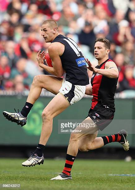 Liam Jones of the Blues marks the ball during the round 23 AFL match between the Essendon Bombers and the Carlton Blues at Melbourne Cricket Ground...