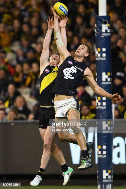 Liam Jones of the Blues spoils a mark by Jack Riewoldt of the Tigers during the round 14 AFL match between the Richmond Tigers and the Carlton Blues...