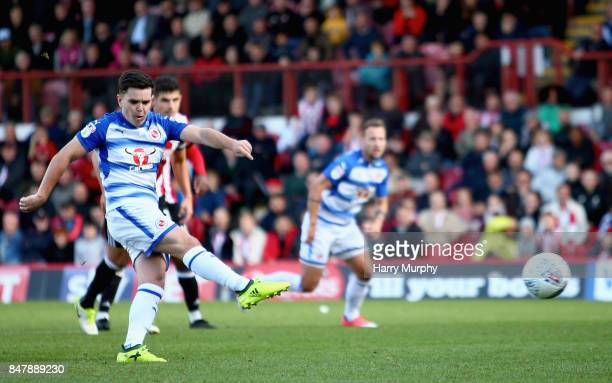 Liam Kelly of Reading scores his teams first goal from the penalty spot during the Sky Bet Championship match between Brentford and Reading at...