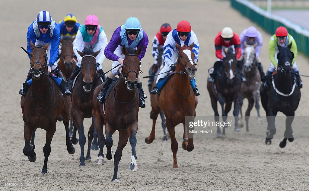 Liam Kenry on Zeus Magic (light blue cap) wins the British Stallion Studs Supporting British Racing E.B.F. Maiden Stakes (Div 2) at Lingfield Park on November 28, 2012 in Lingfield, England.
