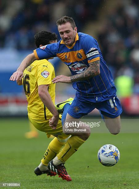 Liam Lawrence of Shrewsbury Town in action with Carl McHugh of Plymouth Argyle during the Sky Bet League Two match between Shrewsbury Town and...