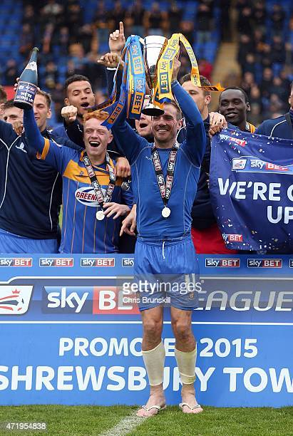 Liam Lawrence of Shrewsbury Town lifts the runners up trophy to celebrate promotion following the Sky Bet League Two match between Shrewsbury Town...
