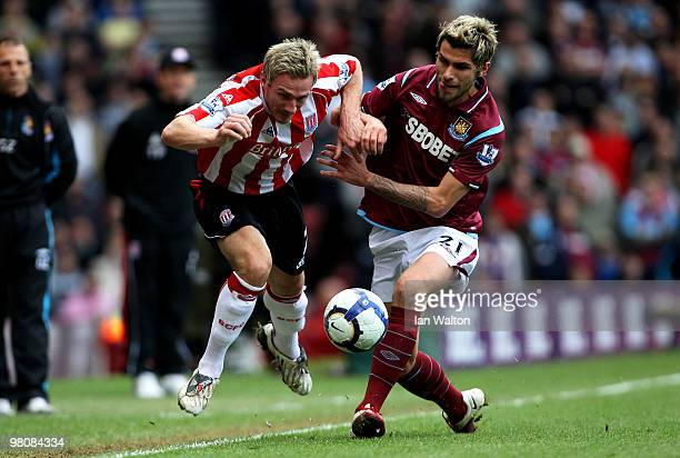 Liam Lawrence of Stoke battles for the ball with Valon Behrami of West Ham during the Barclays Premier League match between West Ham United and Stoke...