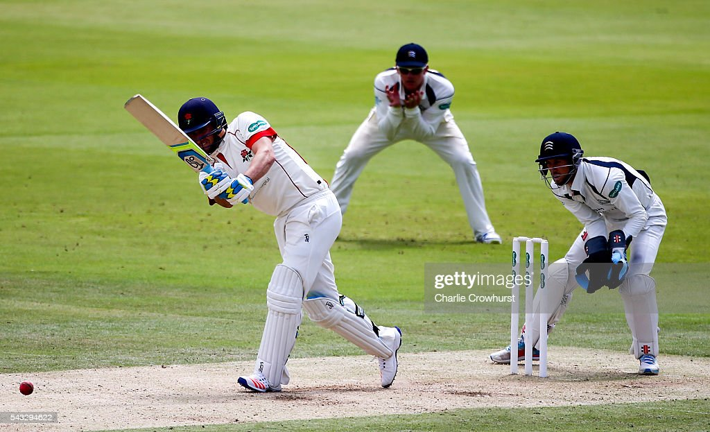 Liam Livingstone of Lancashire hits out as John Simpson of Middlesex (R) looks on during day two of the Specsavers County Championship division one match between Midlesex and Lancashire at Lords on June 27, 2016 in London, England.