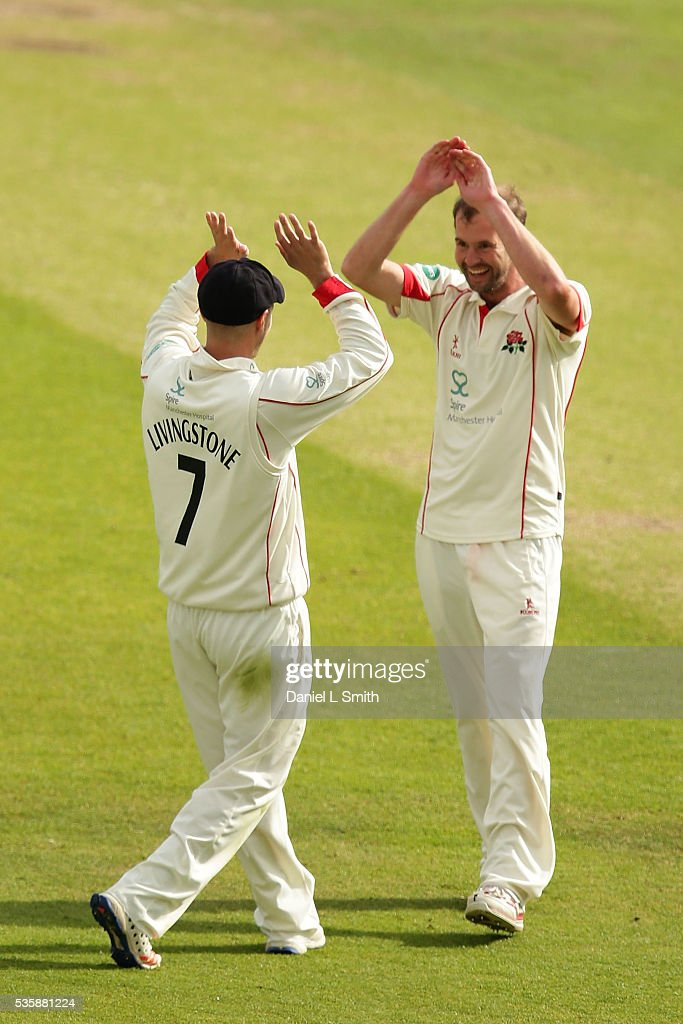 Liam Livingstone of Lanchashire (L) celebrates with <a gi-track='captionPersonalityLinkClicked' href=/galleries/search?phrase=Tom+Smith+-+Cricketprofi&family=editorial&specificpeople=4180561 ng-click='$event.stopPropagation()'>Tom Smith</a> (R) after the dismissal Alex Lees of Yorkshire during day two of the Specsavers County Championship: Division One match between Yorkshire and Lancashire at Headingley on May 30, 2016 in Leeds, England.