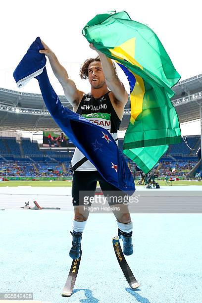Liam Malone of New Zealand celebrates after winning the Men's 400m T44 final and setting a new world record of 4620 seconds on day 8 of the Rio 2016...