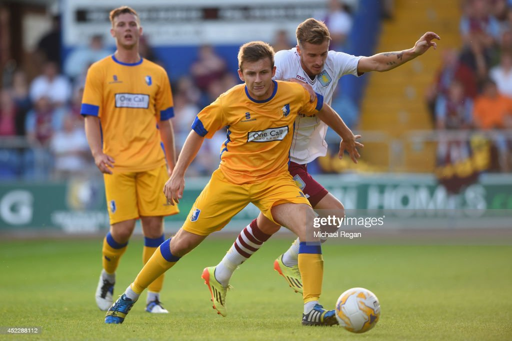 Liam Marsden of Mansfield in action with Joe Bennett of Aston Villa during the pre-season friendly match between Mansfield and Aston Villa at the One Call Stadium on July 17, 2014 in Mansfield, England.