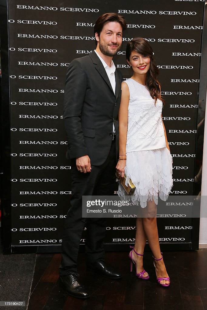 Liam McMahon and Alessandra Mastronardi attend the Ermanno Scervino Store Opening as a part of AltaRoma AltaModa on July 9, 2013 in Rome, Italy.