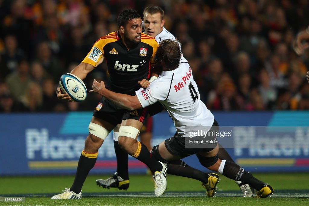 Liam Mesam of the Chiefs looks to offload the ball during the round 11 Super Rugby match between the Chiefs and the Sharks at Waikato Stadium on April 27, 2013 in Hamilton, New Zealand.