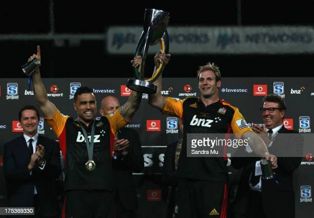 Liam Messam and Craig Clarke of the Chiefs hold the trophy after winning the Super Rugby Final match between the Chiefs and the Brumbies at Waikato...
