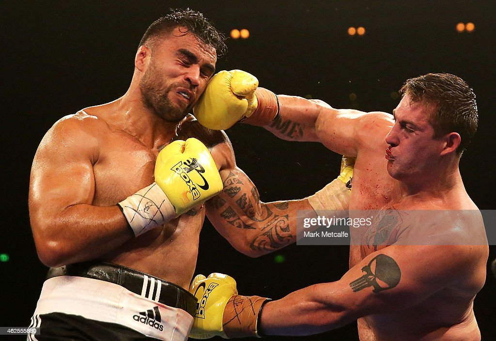 <a gi-track='captionPersonalityLinkClicked' href=/galleries/search?phrase=Liam+Messam&family=editorial&specificpeople=601526 ng-click='$event.stopPropagation()'>Liam Messam</a> fights Rhys Sullivan during their heavyweight bout during the Footy Show Fight Night at Allphones Arena on January 31, 2015 in Sydney, Australia.