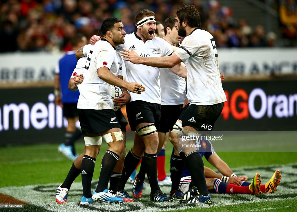 <a gi-track='captionPersonalityLinkClicked' href=/galleries/search?phrase=Liam+Messam&family=editorial&specificpeople=601526 ng-click='$event.stopPropagation()'>Liam Messam</a>, <a gi-track='captionPersonalityLinkClicked' href=/galleries/search?phrase=Kieran+Read&family=editorial&specificpeople=789465 ng-click='$event.stopPropagation()'>Kieran Read</a> and <a gi-track='captionPersonalityLinkClicked' href=/galleries/search?phrase=Sam+Whitelock&family=editorial&specificpeople=6070892 ng-click='$event.stopPropagation()'>Sam Whitelock</a> celebrate Charles Piutau's try during the international test match between France and the New Zealand All Blacks at Stade de France on November 9, 2013 in Paris, France.