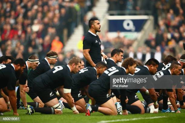 Liam Messam of New Zealand pulls on the shirt of Dan Carter of New Zealand as they perform the Haka during the QBE International match between...