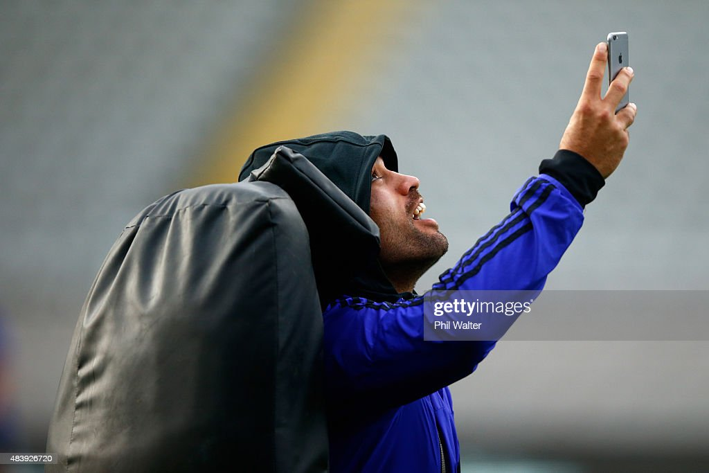 <a gi-track='captionPersonalityLinkClicked' href=/galleries/search?phrase=Liam+Messam&family=editorial&specificpeople=601526 ng-click='$event.stopPropagation()'>Liam Messam</a> of the All Blacks takes a selfie on a smart phone during a New Zealand All Blacks Captain's Run at Eden Park on August 14, 2015 in Auckland, New Zealand.