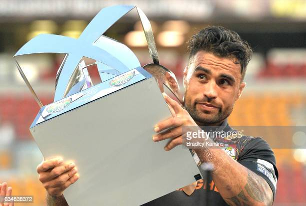 Liam Messam of the Chiefs holds the winners trophy after the Rugby Global Tens Final match between the Crusaders and Chiefs at Suncorp Stadium on...