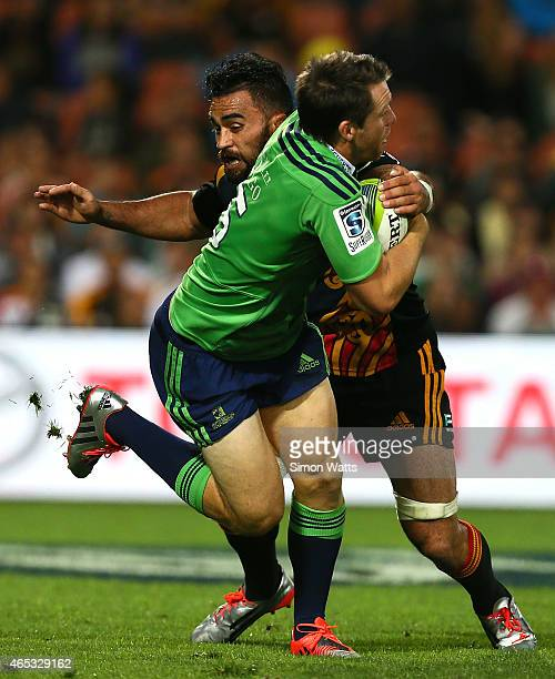 Liam Messam of the Chiefs tackles Ben Smith of the Highlanders during the round four Super Rugby match between the Chiefs and the Highlanders at...