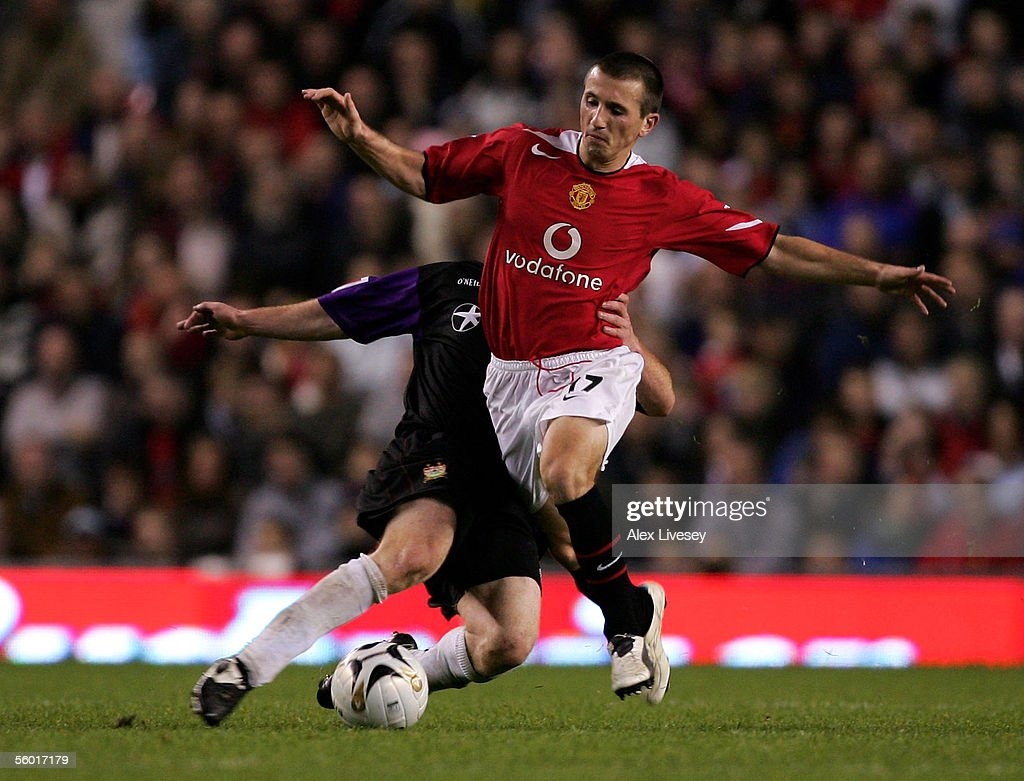 Liam Miller of Manchester United beats Nicky Bailey of Barnet during the Carling Cup third round match between Manchester United and Barnet at Old...