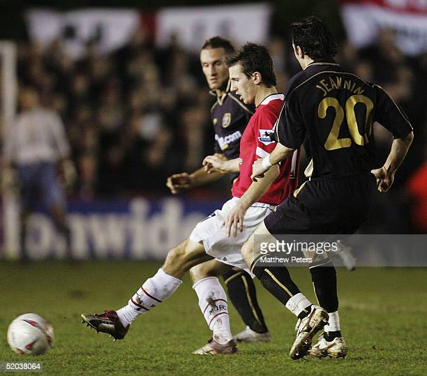 Liam Miller of Manchester United clashes with Alex Jeannin of Exeter City during the FA Cup third round replay match between Exeter City and...