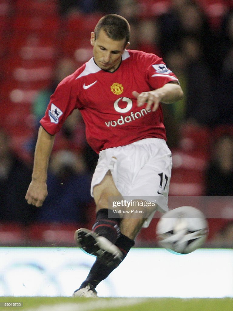 Liam Miller of Manchester United scores the first goal during the Carling Cup third round match between Manchester United and Barnet at Old Trafford...