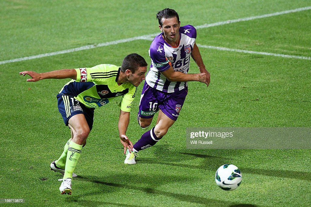 Liam Miller of the Glory challenges Diogo Ferreira for the ball during the round 17 A-League match between the Perth Glory and the Melbourne Victory at nib Stadium on January 19, 2013 in Perth, Australia.