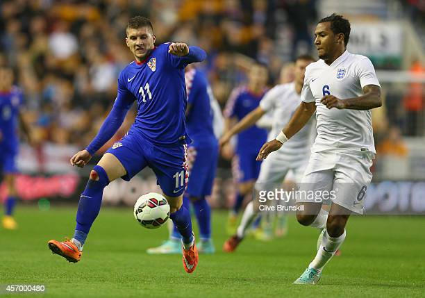 Liam Moore of England in action with Ante Rebic of Croatia during the UEFA U21 Championship Playoff First Leg match between England and Croatia at...