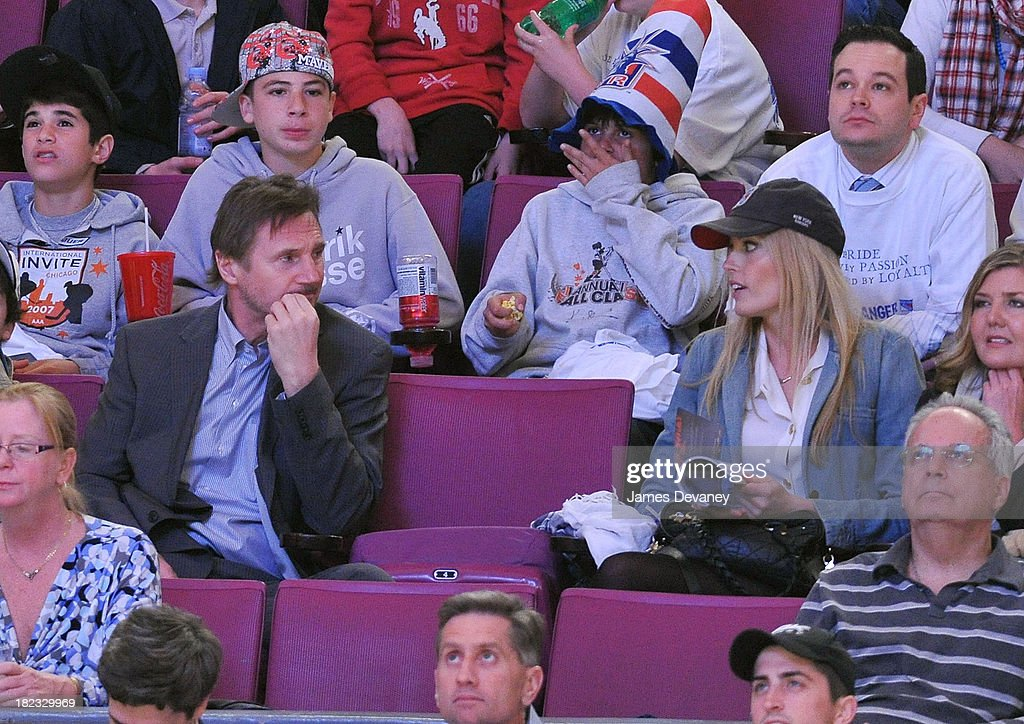 <a gi-track='captionPersonalityLinkClicked' href=/galleries/search?phrase=Liam+Neeson&family=editorial&specificpeople=202030 ng-click='$event.stopPropagation()'>Liam Neeson</a> and Jennifer Ohlsson attend a game between the Philadelphia Flyers and the New York Rangers at Madison Square Garden on April 9, 2010 in New York City.