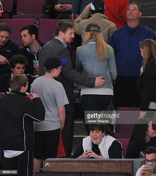 Liam Neeson and Jennifer Ohlsson attend a game between the Philadelphia Flyers and the New York Rangers at Madison Square Garden on April 9 2010 in...