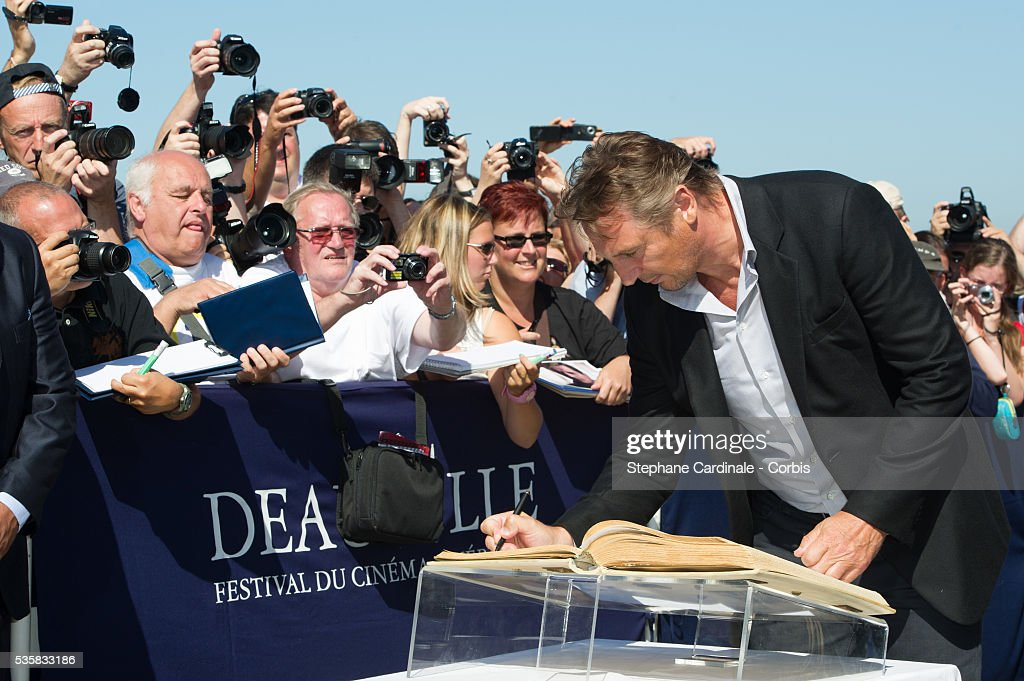 Liam Neeson attends an homage ceremony at Promenade des planches during the 38th Deauville American Film Festival in Deauville