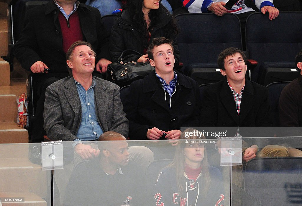 Liam Neeson, Michael Neeson and Daniel Neeson attend the San Jose Sharks vs the New York Rangers game at Madison Square Garden on October 31, 2011 in New York City.