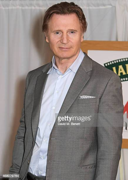Liam Neeson poses in the Winners Room after presenting an award at the Jameson Empire Awards 2015 at Grosvenor House on March 29 2015 in London...