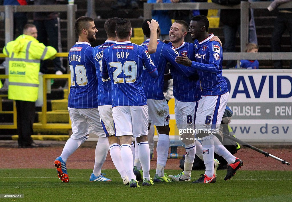 Liam Noble of Carlisle United (2nd R) celebrates with team-mates after he scored the first goal from the penalty spot during the Sky Bet League one match between Carlisle United and Crawley Town at Brunton Park on November 16, 2013 in Carlisle, England.