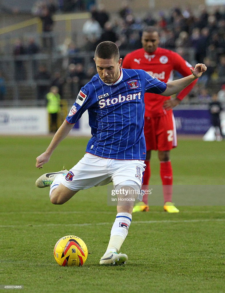 Liam Noble of Carlisle United scores the first goal from the penalty spot during the Sky Bet League one match between Carlisle United and Crawley Town at Brunton Park on November 16, 2013 in Carlisle, England.