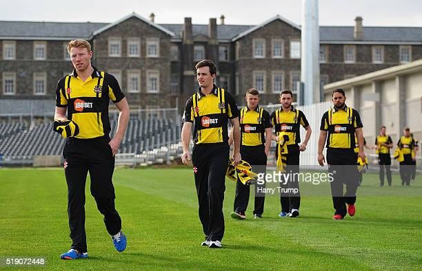 Liam Norwell of Gloucestershire and Gareth Roderick of Gloucestershire make their way towards the press during the Gloucestershire CCC Photocall at...