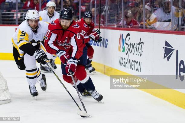 Liam O'Brien of the Washington Capitals and Brian Dumoulin of the Pittsburgh Penguins battle for the puck in the first period at Capital One Arena on...
