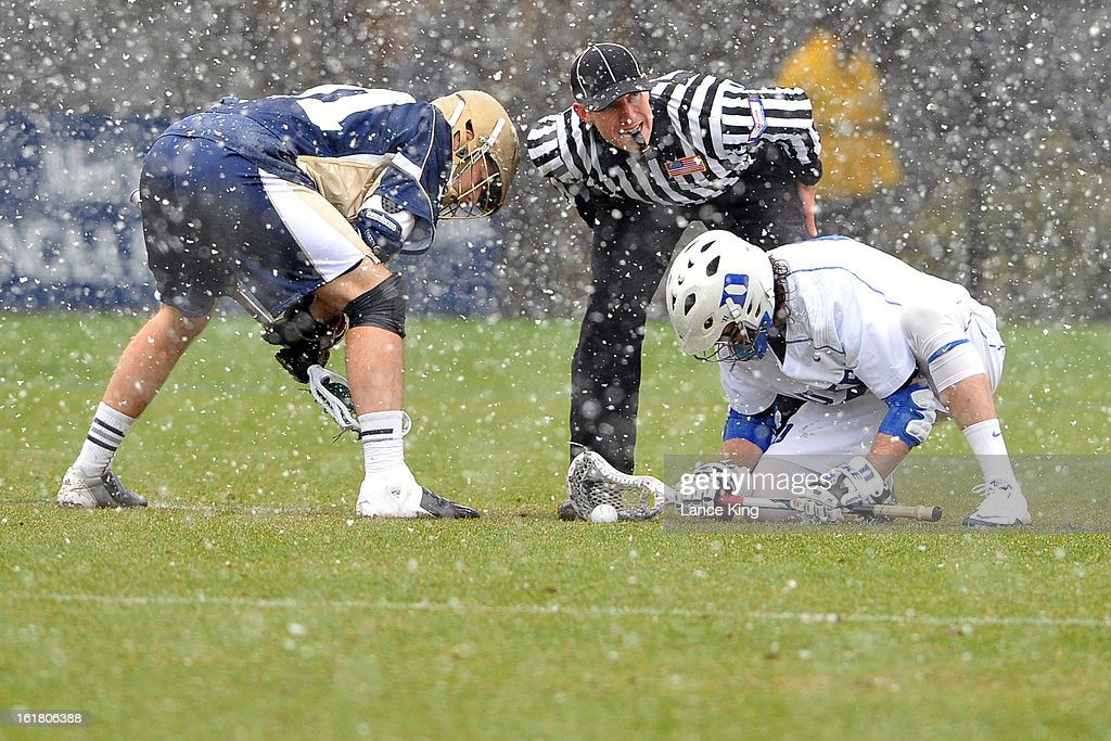Liam O'Connor #31 of the Notre Dame Fighting Irish and Brendan Fowler #3 of the Duke Blue Devils prepare to face-off at Koskinen Stadium on February 16, 2013 in Durham, North Carolina. Notre Dame defeated Duke 13-5.