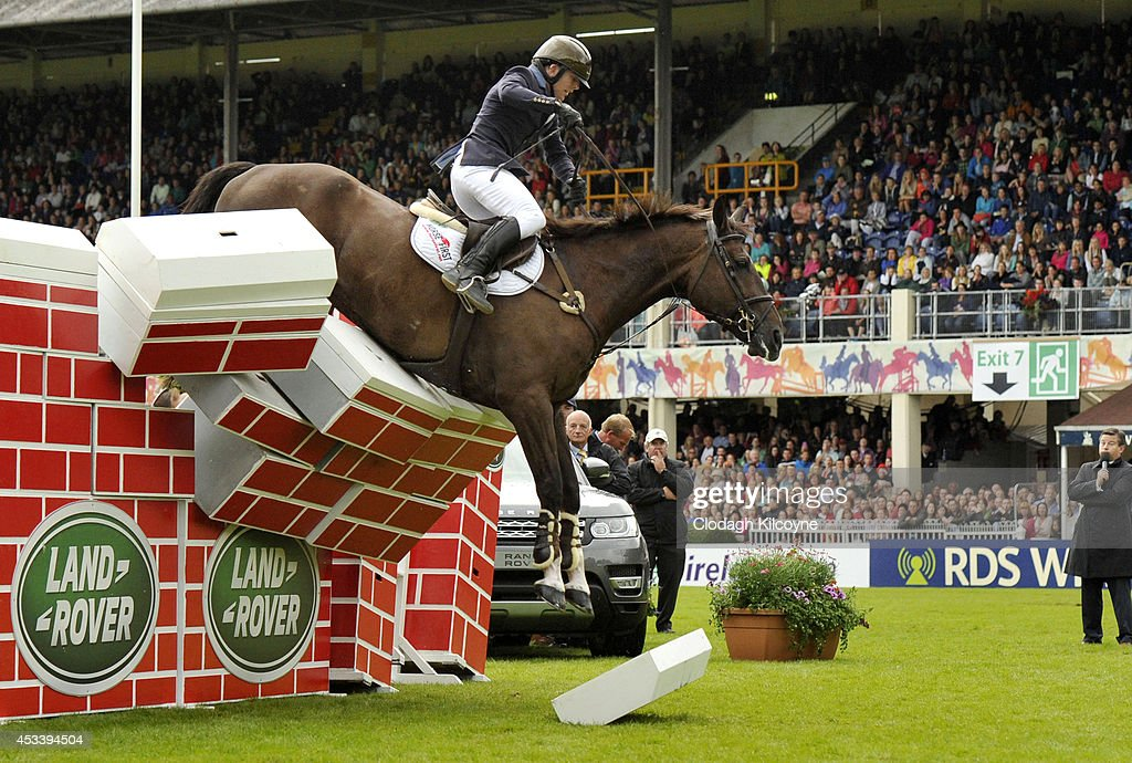 Liam O'Meara riding Cisero, representing Ireland, takes a big fall at 2.20 metres on the 'Puissance' high wall challenge at the Dublin Horse Show 2014 on August 9, 2014 in Dublin, Ireland.