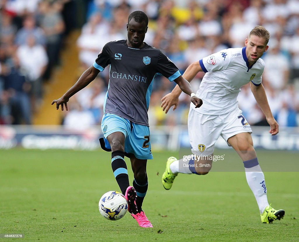 Liam Palmer of Sheffield Wednesday FC maintainls control over Charlie Taylor of Leeds United FC during the Sky Bet Championship match between Leeds United and Sheffield Wednesday at Elland Road on August 22, 2015 in Leeds, England.