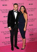 Liam Payne and Danielle Peazer attend the annual Victoria's Secret fashion show at Earls Court on December 2 2014 in London England